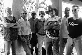 Allman Brothers Band 1999:  (l. to r.) Gregg Allman, Butch Trucks,  Jaimoe, Jack Pearson, Dickey Betts, Oteil Burbridge, Marc Quinones